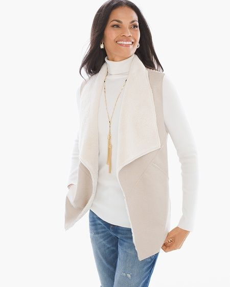 """Part warm, part cozy, all fabulous. There are two chic sides to this modern faux-shearling vest, with a sueded texture on the front and beautiful woven knit in the back.  Open-front design.  Woven sweater fabric in the back back.  Length: 26"""".  Polyester.  Hand wash. Imported."""