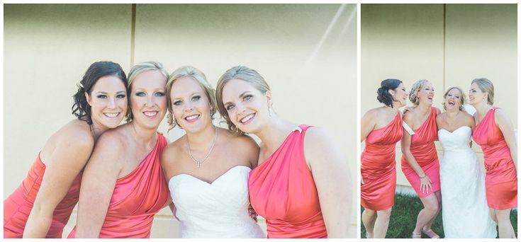 Bridesmaids in coral dresses. Oakville Harbour Wedding. Ontario wedding
