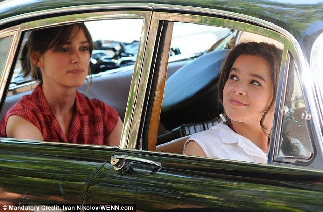 Riding in cars with girls: Hailee changed into a white blouse to film in the car with Keira Knightley