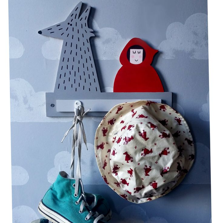 These eco-friendly  little red riding hood hooks will add a touch of fun to any child's bedroom decor.   Made of 9 mm birch plywood responsibly sourced, the set comes with 2 single robe hooks and screws directly unto the wall.  DIMENSIONS:  (W) 32cm x (H) 27cm