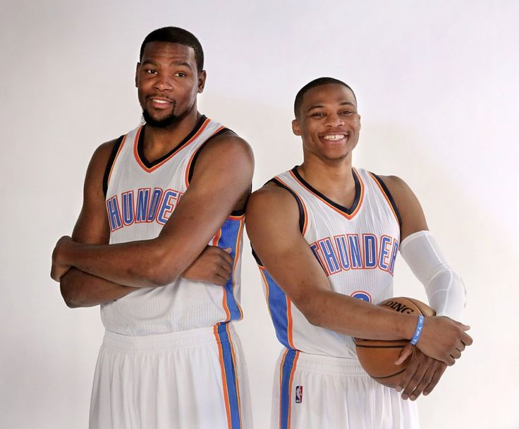 Teammates Kevin Durant, left, and Russell Westbrook pose for photographers during OKC Thunder Media Day in Chesapeake Arena on Monday, Sep. 29, 2014.  Photo by Jim Beckel, The Oklahoman