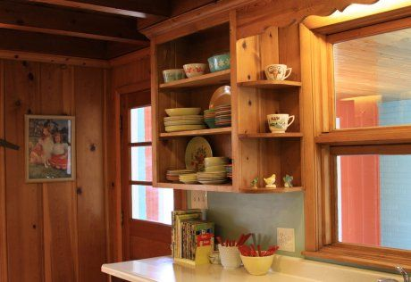knotty-pine-kitchen-cabinets-with-window-cubbies