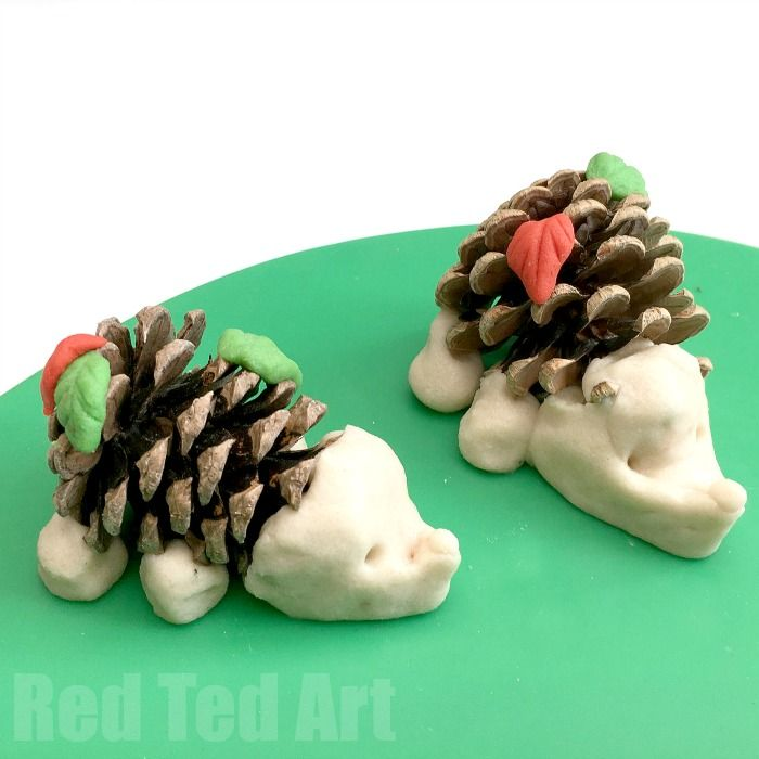 Pine cone crafts for kids - love these little pine cone hedgehog. Combine this wonderful autumn nature fine - the prickly but tactile pine cone with this great basic salt dough recipe. Too cute! How I love a Hedgehog Craft for Kids!