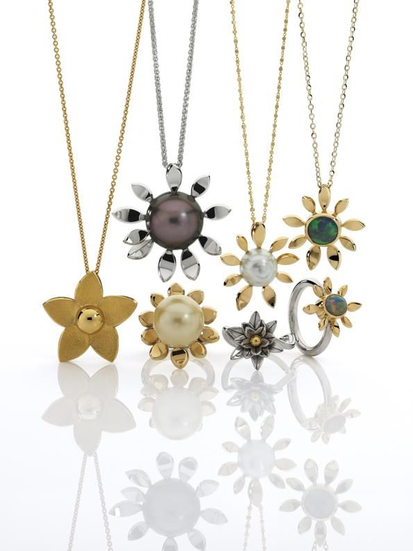 Flower pendants in 18K yellow and white gold with Australian pearls, a Tahitian pearl and Australian opals