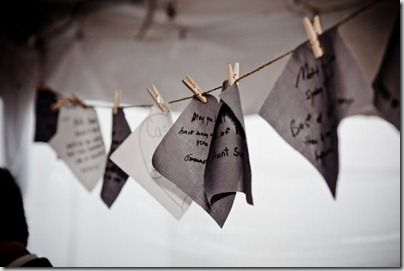 How beautiful! Guests leave notes on the ends of the table cloth which is later cut out by the end of the night to be made into a wedding quilt. <3