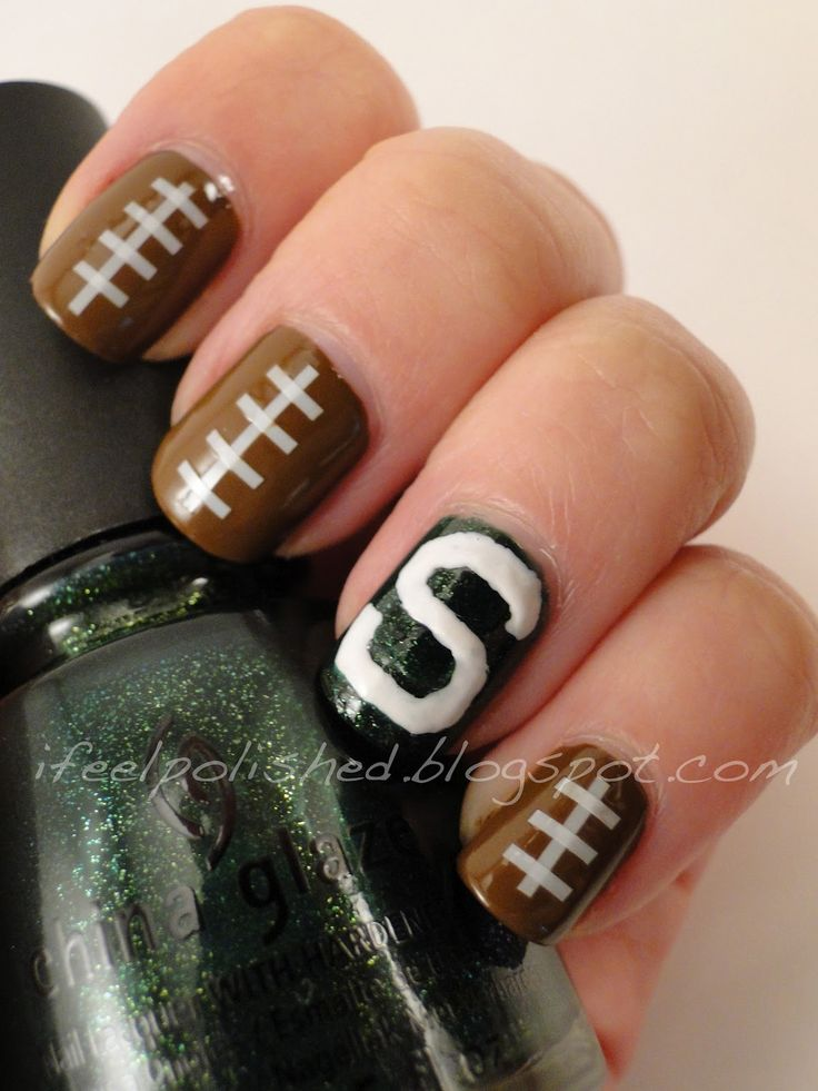 Michigan State University.....could be done with blue instead of green, and a white horseshoe.  ;) GO colts!