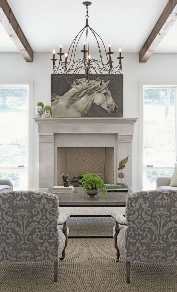 Love the herringbone fireplace. The chairs & equine art are pretty sweet also | Equestrian interior design : Equestrian Chic
