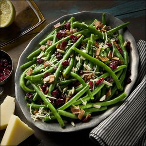 Green Beans With Cranberries & Bacon: 1 ½ lb. Green Beans, ¼ lb. Bacon, ½ Cup Dried Cranberries, ¼ Cup Parmesan Cheese, ½ Cup Slivered Almonds, Juice of 1 Lemon, Fresh Sage, Olive Oil, 1 Cup Water, Salt & Pepper