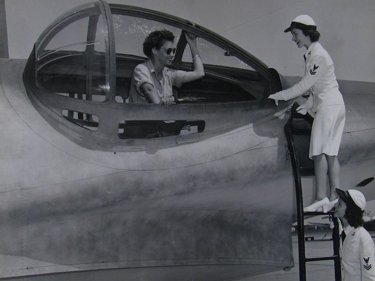The Gun Turret. Navy WAVE demonstrates aircraft work to fellow WAVE during World War II.