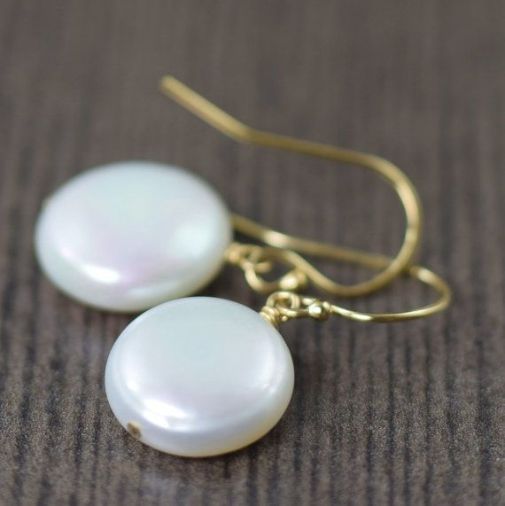 Mothers day gift ideas // Simply classic, these freshwater, coin-shaped earrings feature AAA-grade, high-luster pearls. The pure white pearls are accented by lightweight gold-filled wires. Each pearl will vary in shape and size since they are natural freshwater pearls however I do my best to pair them up properly. The general size /shape of each pearl is between 12-13mm with a coin shape. shopsouthpaw.com