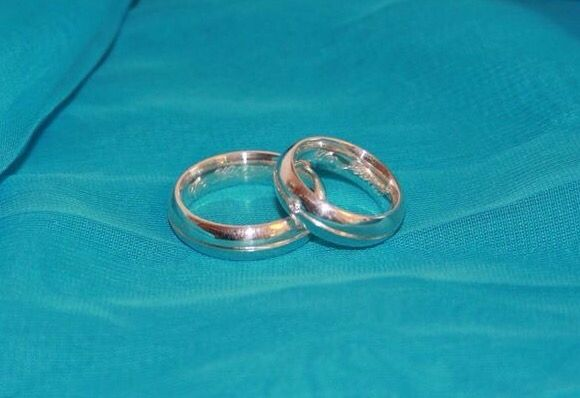 Our rings in mine stands Tín Jeann and in my fiancés stands Tín Kirstin