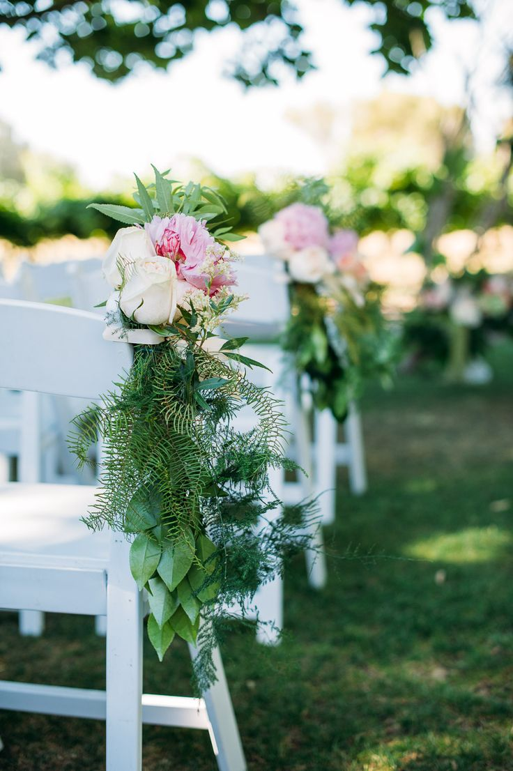 Gorgeous floral detailing on the wedding ceremony chairs