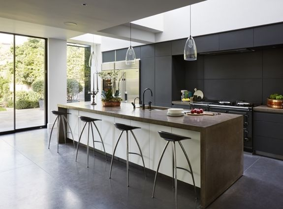 Bespoke bulthaup living: Kitchen Architecture's bulthaup b3 and b1 furniture in graphite and alpine white with bespoke concrete work surfaces. #bulthaup #kitchens #b1 #b3 #kitchenarchitecture #white #graphite #kitchenarchitecturesbulthaup #concrete