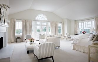 Hamptons style living room with neutral curtains