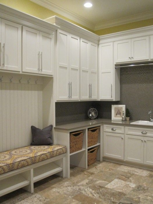 Mudroom Laundry Room Bench With Pantry Closet Beside It Washer Dryer On Opposite Wall With A Place To Hang Clothes