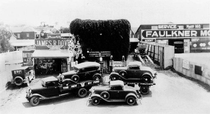 Demonstration of new Ford roadsters and a Ford truck, at James Dover's garage, Boonah, 1933 - The tourer and two roadsters are all Ford. The first with the V8 engine. The truck is also a Ford the 2-ton chassis with 157 inch wheelbase.