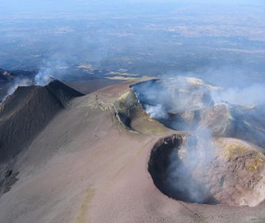 Mount Etna, Italy  On the eastern coast of Sicily, near the cities of Messina and Catania, Mount Etna is one of the most active volcanoes ...