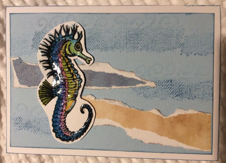 'Seahorse' created using Lyra Aquacrayons, Glossy Accents, Ancient Page 'coal black' waterproof dye ink, ColorBox fluid chalk 'Prussian Blue' ink. Stamps by Kaszazz. Kaszazz paper and Bazzil Basics card. Live Love Cards May Challenge - Watercolours. http://livelovecards.com
