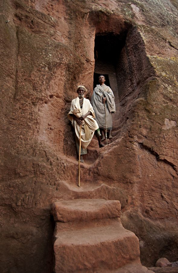 Ethiopia - Pilgrims at the entrance of a rock- hewn church in Lalibela, Ethiopia,