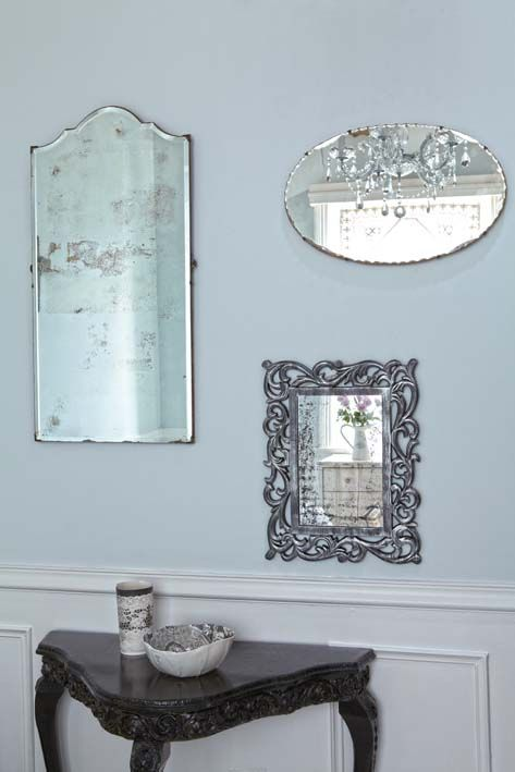 Old mirrors are part of the vintage trend, but you can also give a new mirror an antique look.