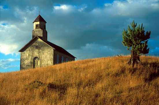 colorful wooden churches on island of chiloe, chile