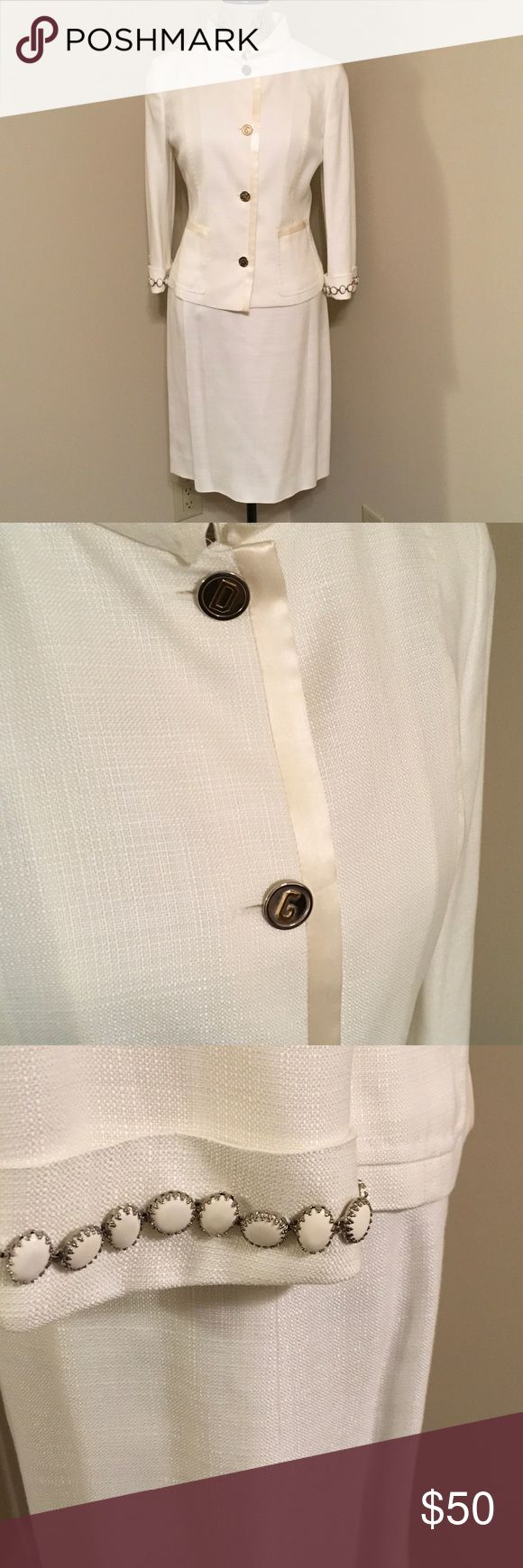 Dolce and Gabana white suit Dolce and Gabana white rayon suit with white silk accents. The buttons are silver with a gold D on some and gold G on others. The fabric resembles linen but does not wrinkle dolce snd Gabana Skirts Skirt Sets