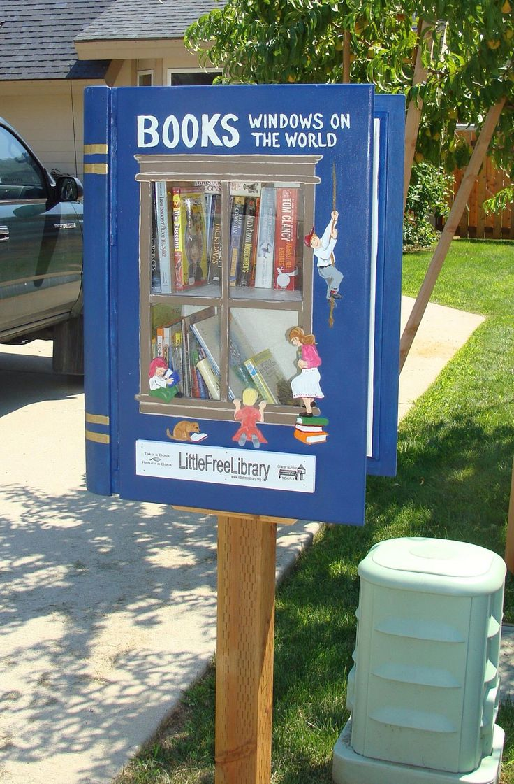 Little Free Library that looks like a book.  Open the book to get a book.
