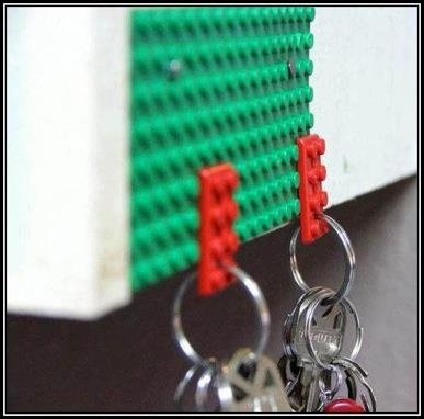 Mount a lego piece on a wall/board by your door. Then put a tiny lego piece on your keychain by drilling hole through it.