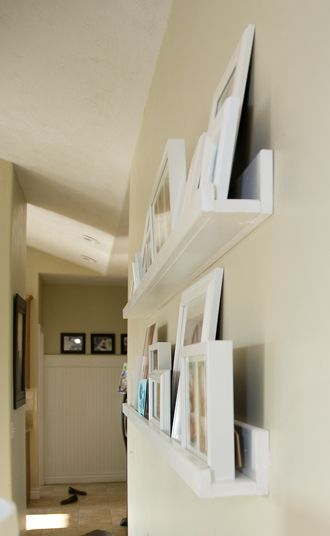 DIY wall shelf easy to change around and not worrying about making holes in the wall if you want to move/change a picture/frame around!