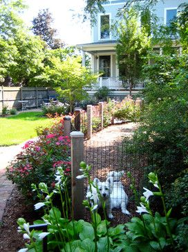 A dog run doesn't have to be a cage but separation is sometimes necessary especially with a multiple-dog household.