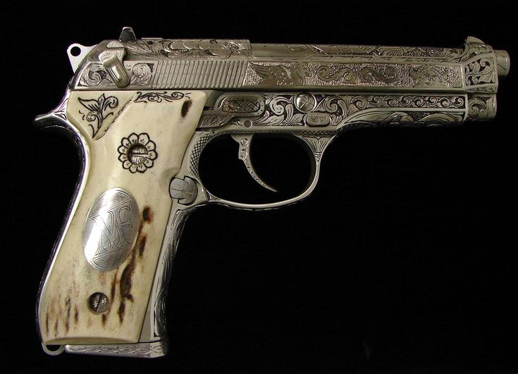 Beretta 92 9MM -  Outstanding custom engraved gun done in an elaborate Mayan motif with nickel plating and carved stag grips. A beautiful work of art.