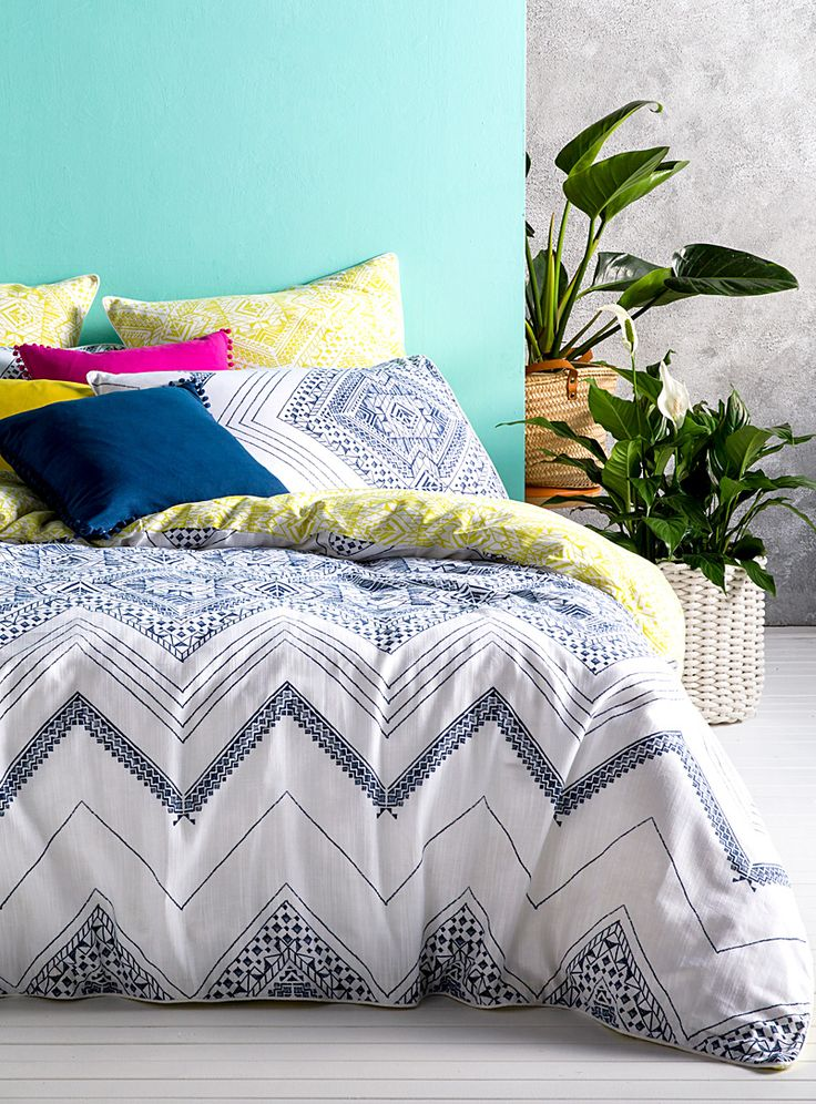 Kas Australia at Simons Maison. Duvet cover with intricate Aztec-inspired patterns in sophisticated ink blue hues on 100% textured cotton.