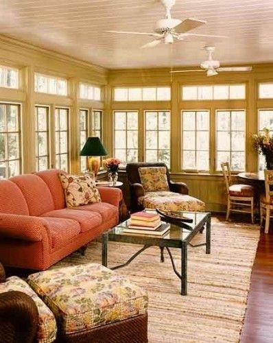 Sunroom. Love the bead board ceilings, walls and rug.
