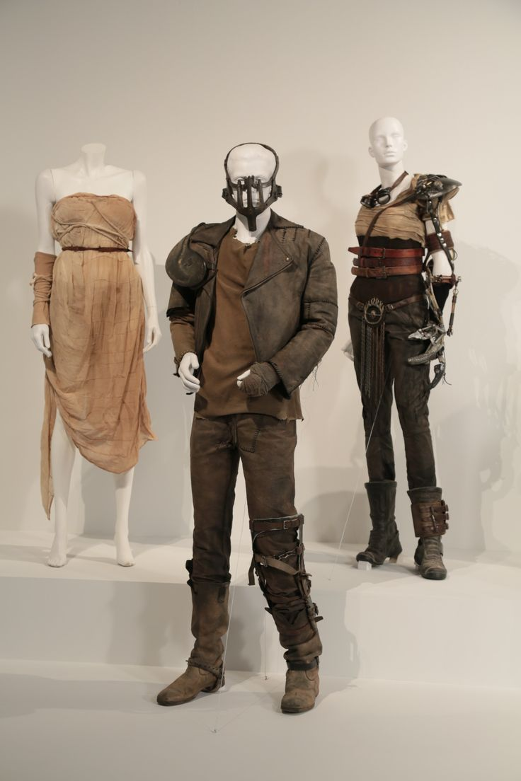 "Mad Max: Fury Road costumes by Jenny Beavan, Academy Award nominee for Costume Design. These costumes can be seen in the 24th Annual ""Art of Motion Picture Costume Design"" exhibition, FIDM Museum, Los Angeles. The exhibition is free to the public, Tuesday, February 9 through Saturday, April 30, 2016, 10:00 a.m. - 5:00 p.m. ..(L to R) Costumes worn by actors: Courtney Eaton as Cheedo the Fragile, Tom Hardy as Max Rockatansky, Charlize Theron as Imperat Furiosa.(Photo: Alex J…"