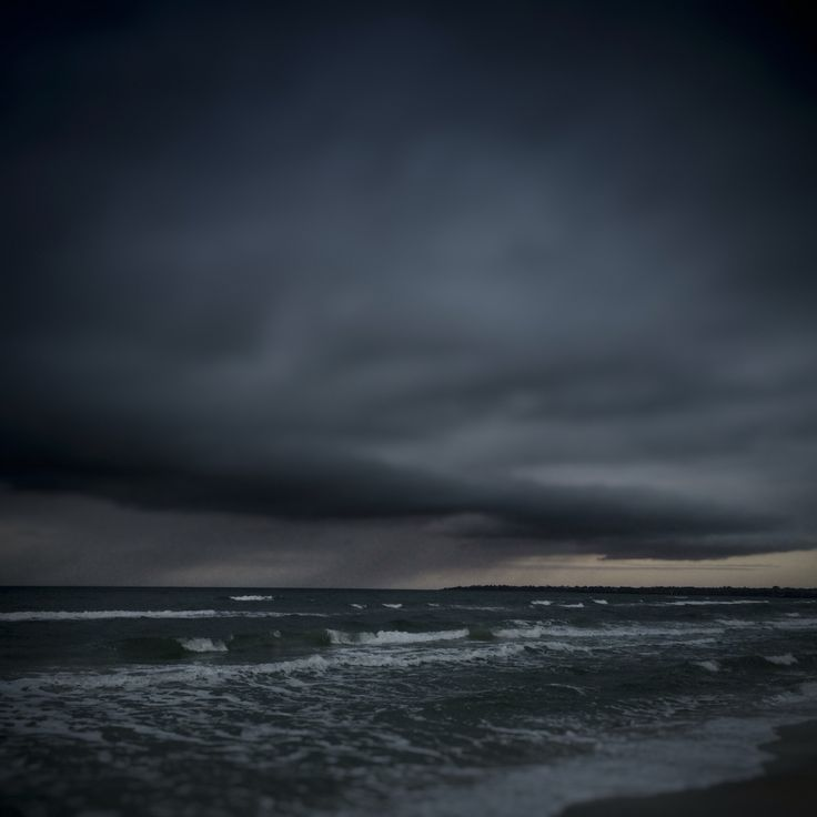 Storm rolling in across Port Phillip Bay towards Aspendale Beach