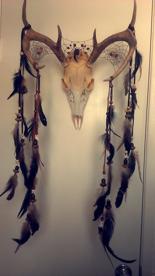 Another deer skull dream catcher. I made this one for a friends wedding. Everything on it is natural stones, bone, or wood.