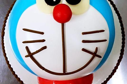 2D Doraemon Cake - Demonstration on how to handle the ingredients and prepare a batch of Special Fresh Cream. Full Hands-on:- Craft, fill & crumb coat Doraemon cake with special fresh cream. Decorate and do the finishing touches for the 2D Doraemon cake. (LessonsGoWhere.com.sg)