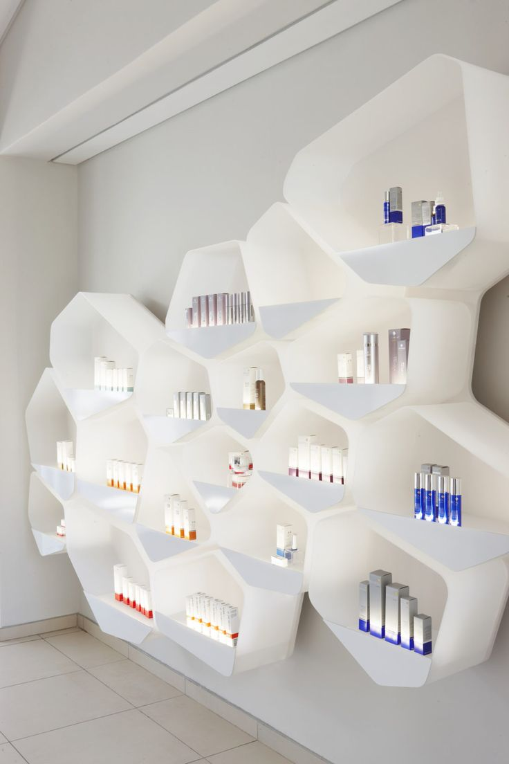 reception display shelf at Environ Skin Care Offices and Reception interior and furniture design by Haldane Martin