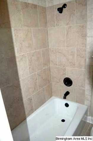 tile tub surround pictures   Cast-iron-tub-ceramic-tile-flooring-and-shower-surrounds-are-also ...