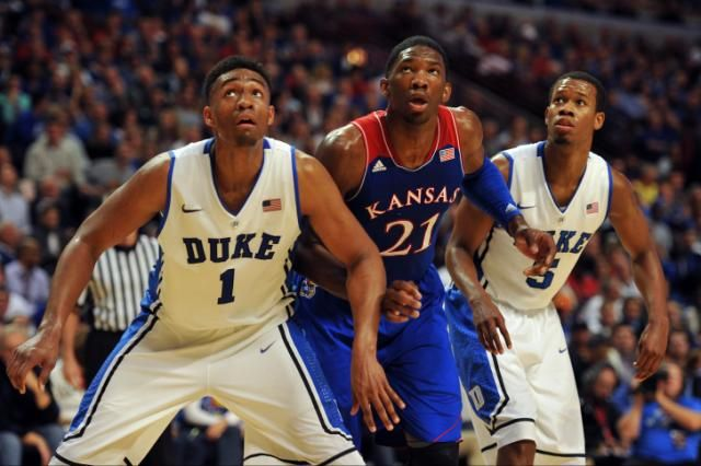 Duke Blue Devils forward Jabari Parker (1) and forward Rodney Hood (5) fight for position with Kansas Jayhawks center Joel Embiid (21) durin...