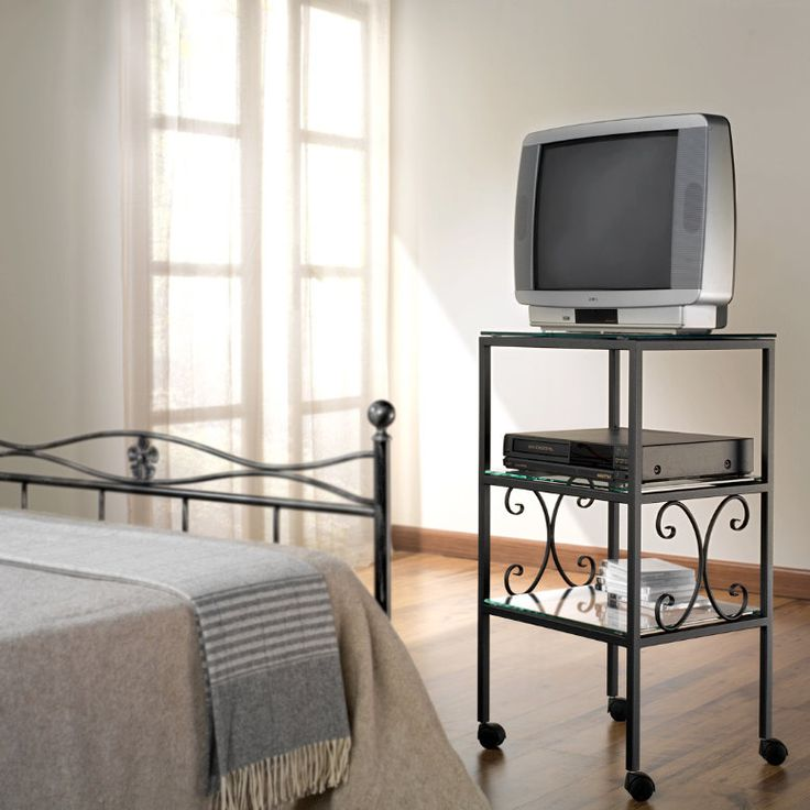 Ritz TV Holder by Cosatto You may think that keeping a TV in your bedroom is not that elegant - but we have a solution: this piece will give to your TV a very sophisticated look.  The wrought iron frame makes it great to move, light and resistant at the same time.