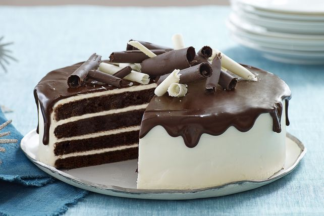 When the occasion calls for something elegant, this dramatic-looking chocolate Tuxedo Cake with white frosting and chocolate glaze is the one to make!