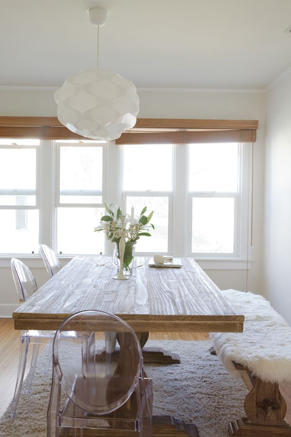 Modern chairs + farmhouse table. Love the idea of fur for the winter, and could swap with fun cushions for summer