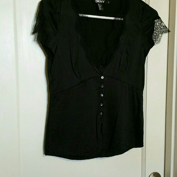 Black silk shirt Black silk shirt with lace detailing around neck and sleeves. Button front. Scoop neck. DKNY Tops