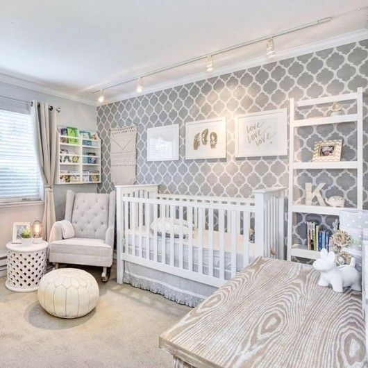 A gray and white nursery with a stenciled accent wall using the Casablanca Allover Stencil from Cutting Edge Stencils. http://www.cuttingedgestencils.com/allover-stencils.html