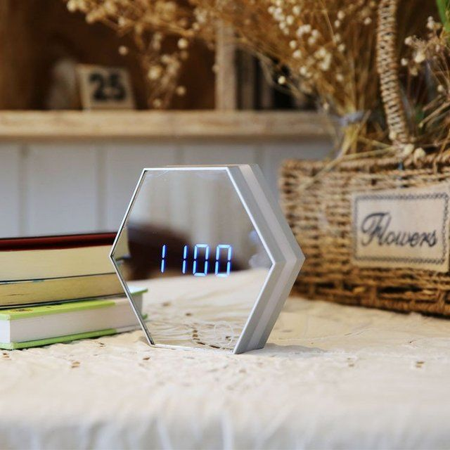 LED digital Alarm Clock with LCD displays month,date,hour and minute.Blue numbers will magically show up on the mirror surface.