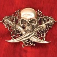 """Letter of Marque Belt Buckle This intricately designed belt buckle is hand crafted in England and is made of fine English pewter. Measuring a full 4"""" X 2-3/4"""", it can accept up to a 1-1/2"""" wide belt (not included)."""