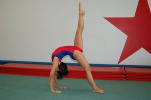 Do a bridge with one leg up to learn a back walkover - © 2009 Paula Tribble