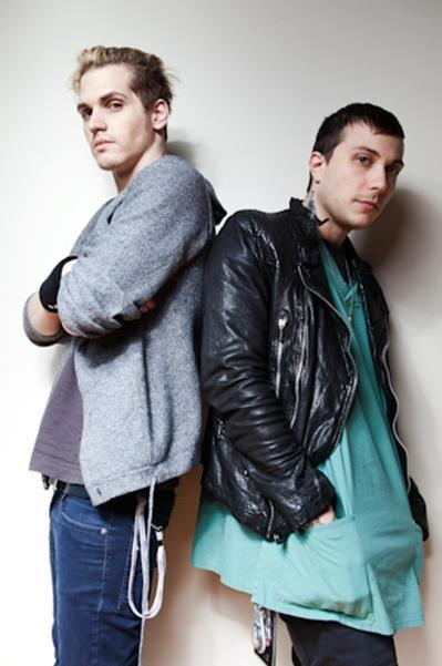 Mikey Way and Frank Iero  franks so cute and small! and what is he wearing?! but mikeys just there looking awesome as per