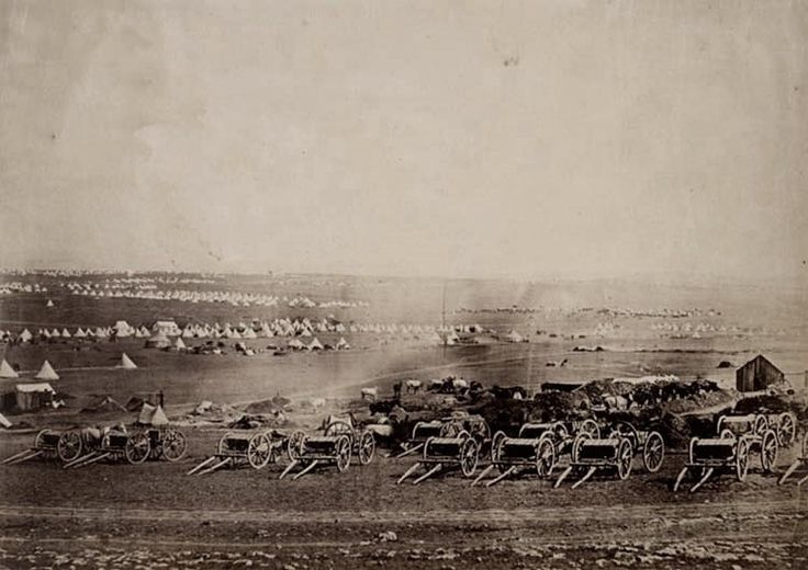 View of the plateau of Sebastopol showing rows of caissons, with tents on the plains in the background.